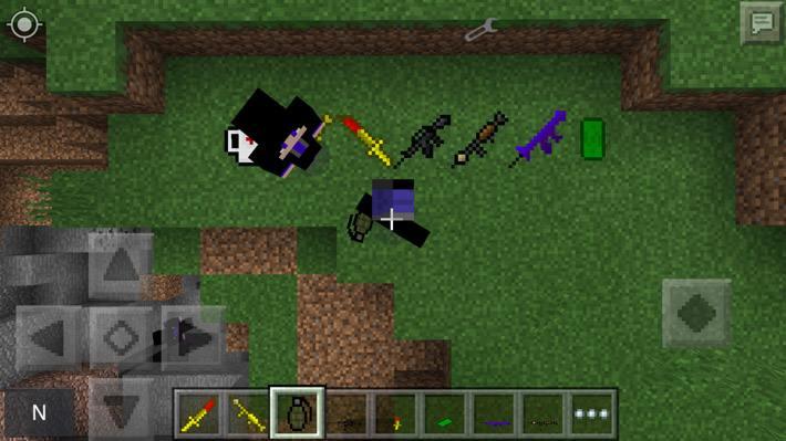 Автоматы на земле и граната в руках у игрока